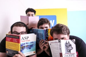 apprentices holding books