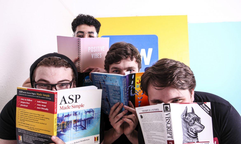 apprentices holding books