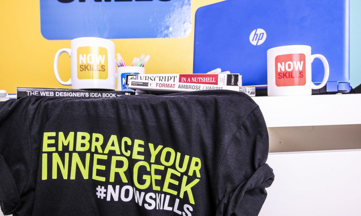 nowskills cups. shirt and laptop