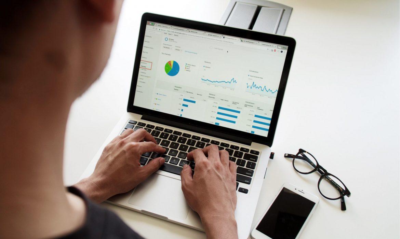 Data Analyst apprentice working on laptop