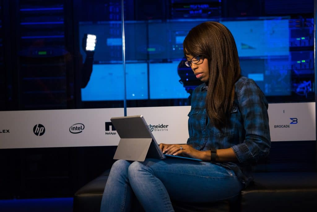 a digital apprentice working on her laptop.