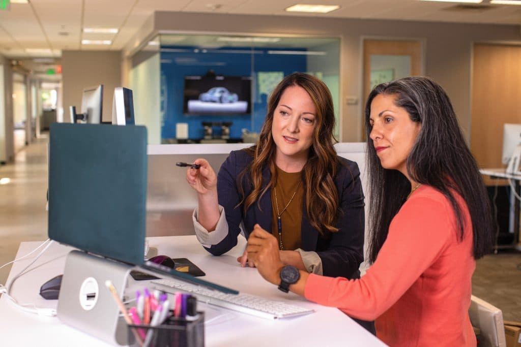 Two female workers in the business services industry